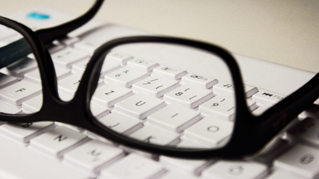 Glasses on a computer keyboard